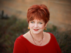 Image of Sandra Rogers, licensed psychotherapist and author of Inviting the Queen: An Emerging Archetype for Women at Midlife - on Voices of Courage with Ken D. Foster
