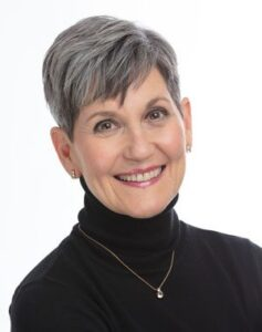 Image of Lynne McTaggart, award-winning author of seven books, including the internationally bestselling The Intention Experiment, The Field, The Bond, and her new book The Power of Eight - on Voices of Courage with Ken D Foster